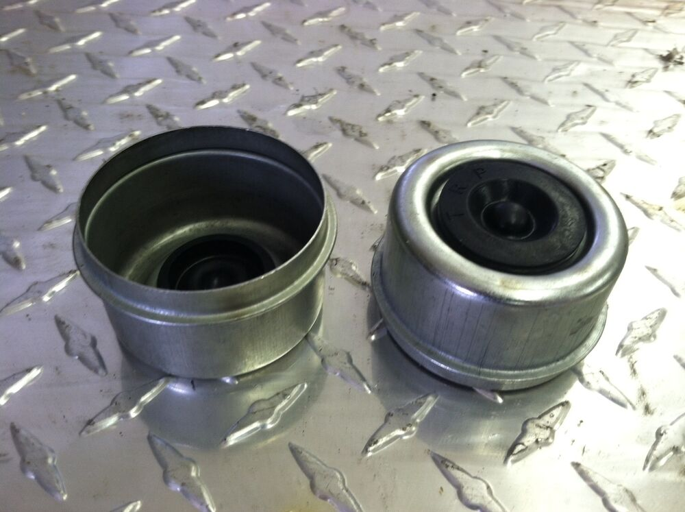 Grease Cap Plug : Metal grease caps with rubber plugs for dexter and