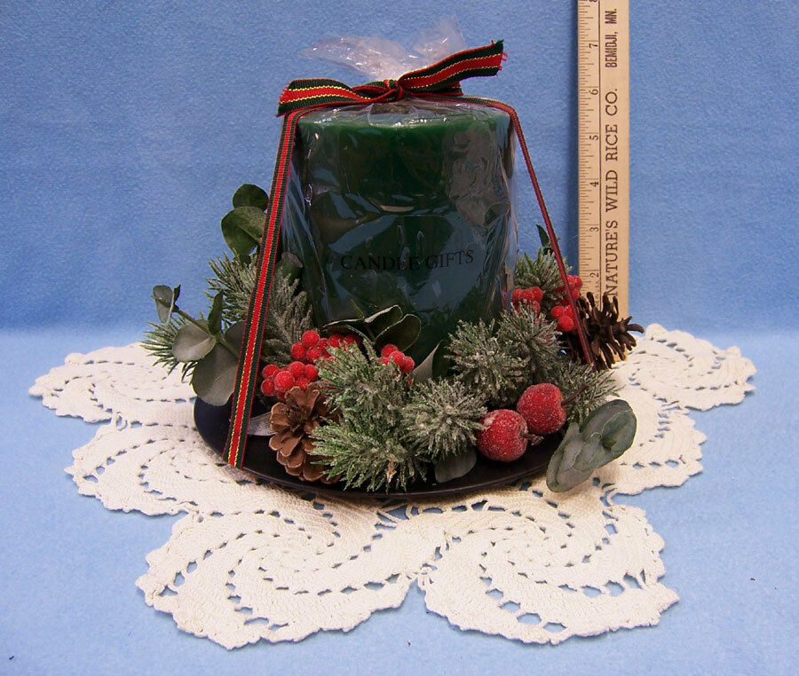 Christmas candle centerpiece with holly pine cones