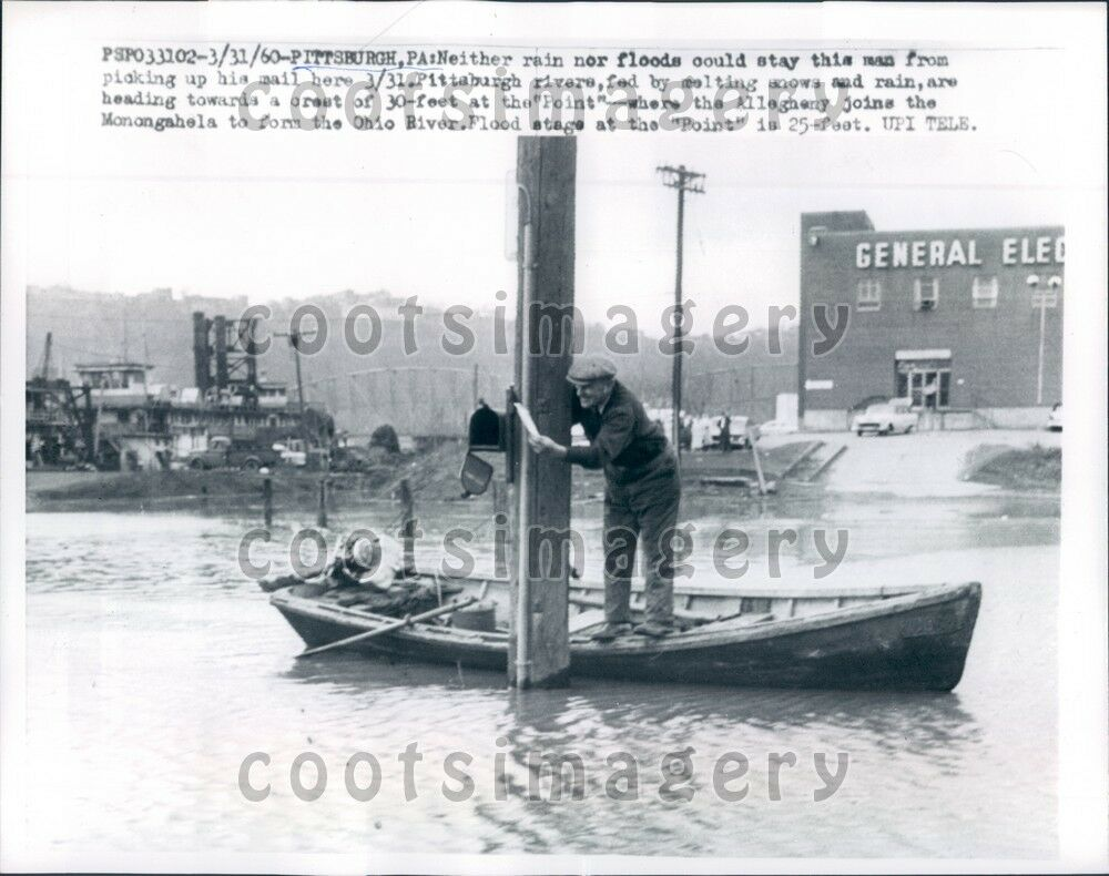 1960 pittsburgh pa man takes boat to mailbox during flood for Boat mailbox