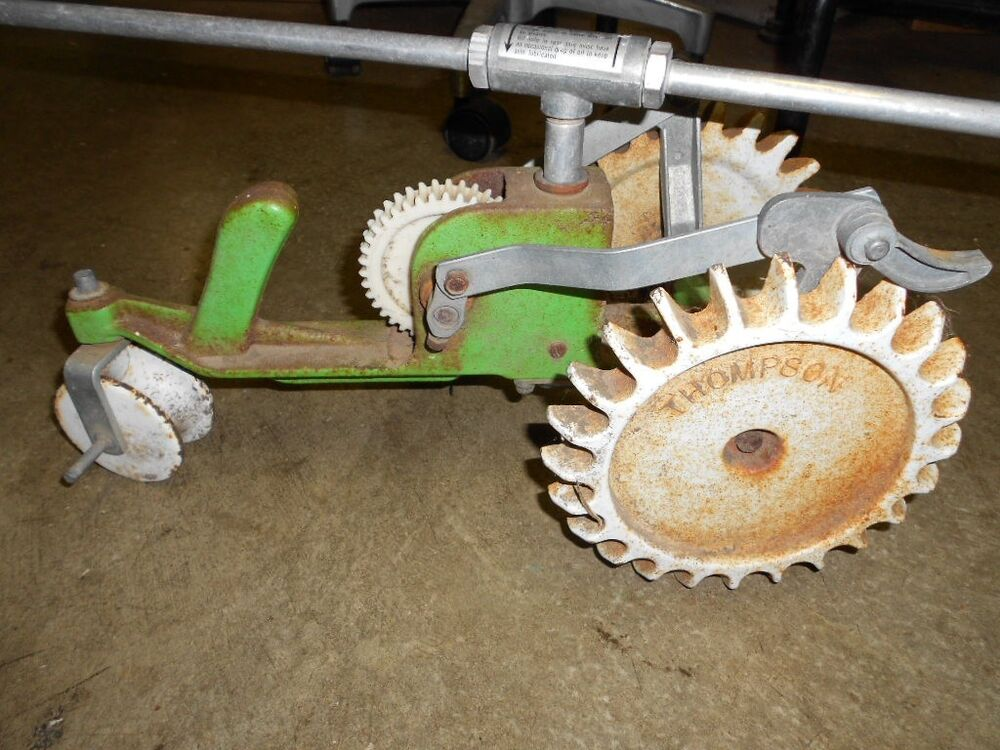 Traveling Lawn Sprinkler Tractor : Vintage cast iron thompson traveling tractor lawn