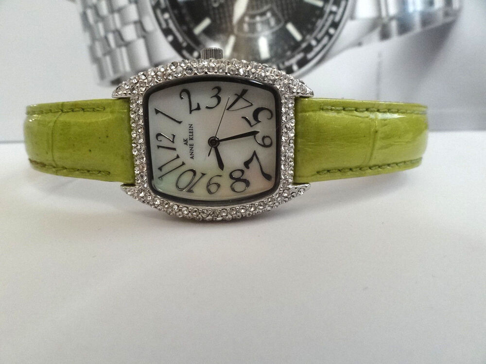 Ak anne klein 10 7167 mother of pearl green leather band crystal women 39 s watch ebay for Anne klein y121e