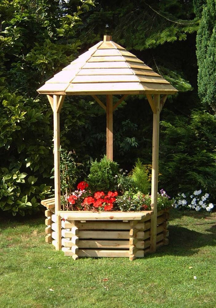 Wooden wishing well planter with seats easy raised garden for Well pictures