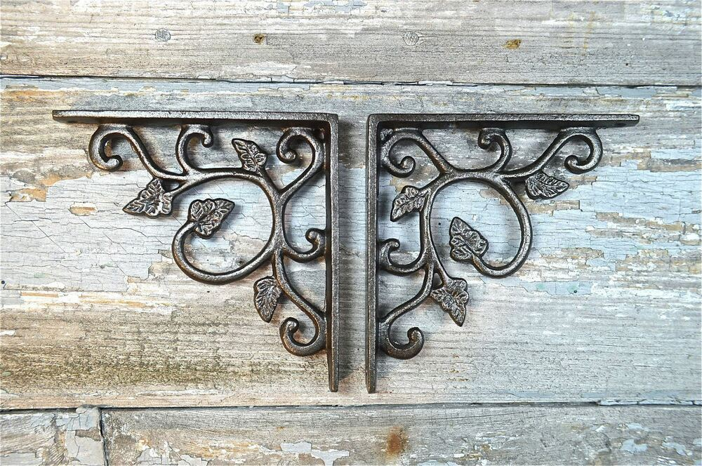 PAIR OF ARTS AND CRAFTS LEAF CAST IRON SHELF BRACKETS