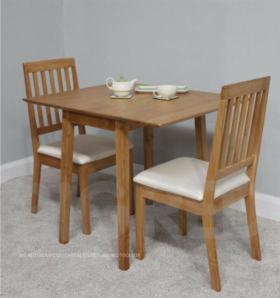 Solid wood extending dining table 2 chairs oak finish for Solid wood dining table sets
