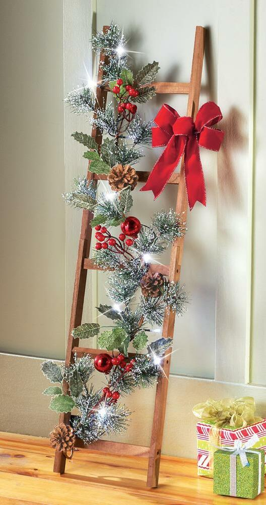 Wood ladder w lighted pine boughs red ornaments for Crismas de navidad
