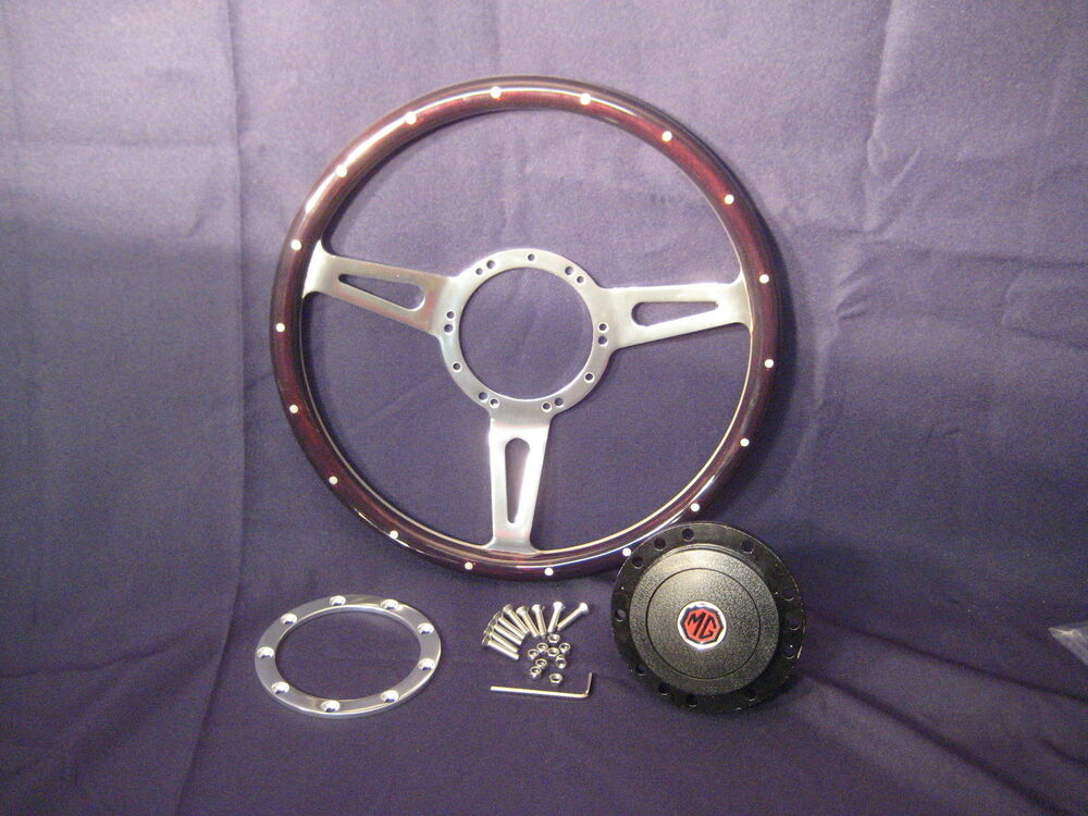 Perfect girl! mg midget steering wheel don't think so