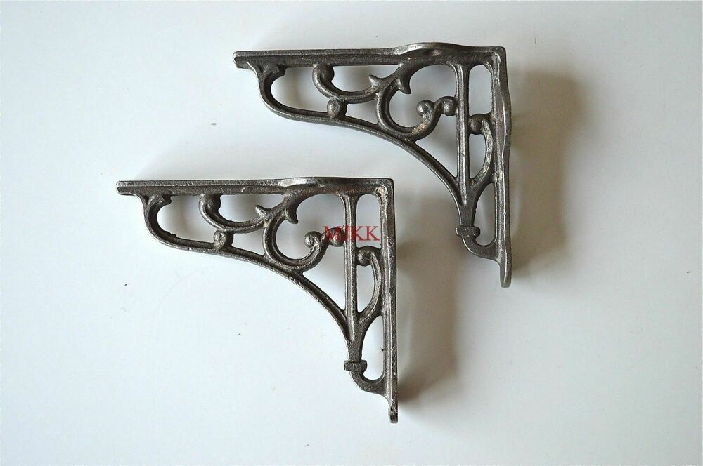 A Pair Of Small Victorian Scrolled Cast Iron Brackets 4
