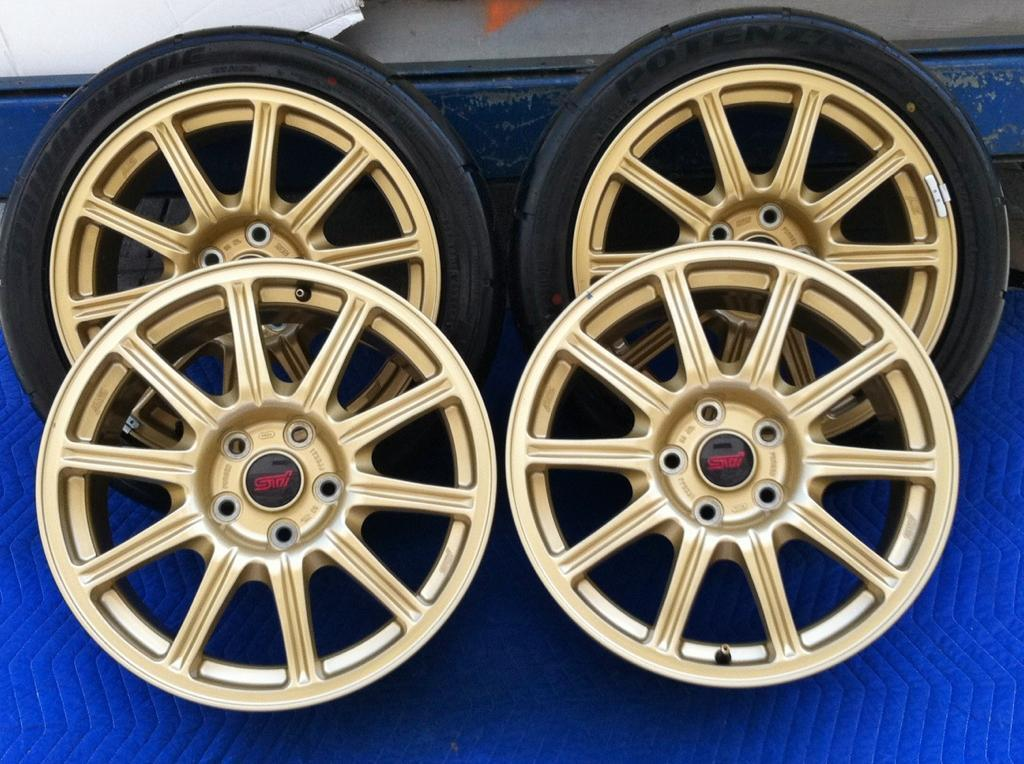 07 Subaru STI Gold BBs Factory Wheels Tires