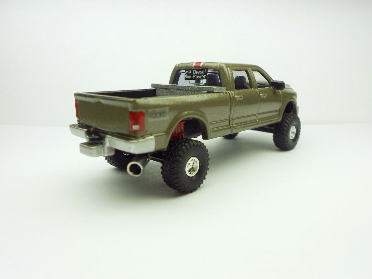 Toy+Pickup+Trucks Ertl Custom Lifted Chevy Duramax 3500 Dually Toy ...