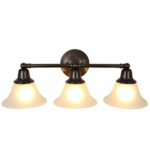 Innovative Quality And Style Make Up This Attractive Five Light Bathroom Fixture From The Minka Lavery Paradox Collection The Strong Lines Are Softened With A Smart Bronze Finish And Etched Marble Glass This Bronze Fixture Will Add Comfort And Style