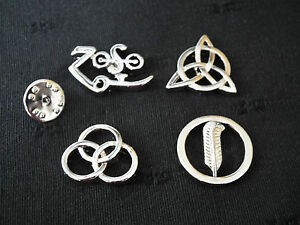 LED Zeppelin Runes Symbols http://www.ebay.com/itm/Led-Zeppelin-Runes-4-Symbols-Badges-with-locking-Clips-/300802377026