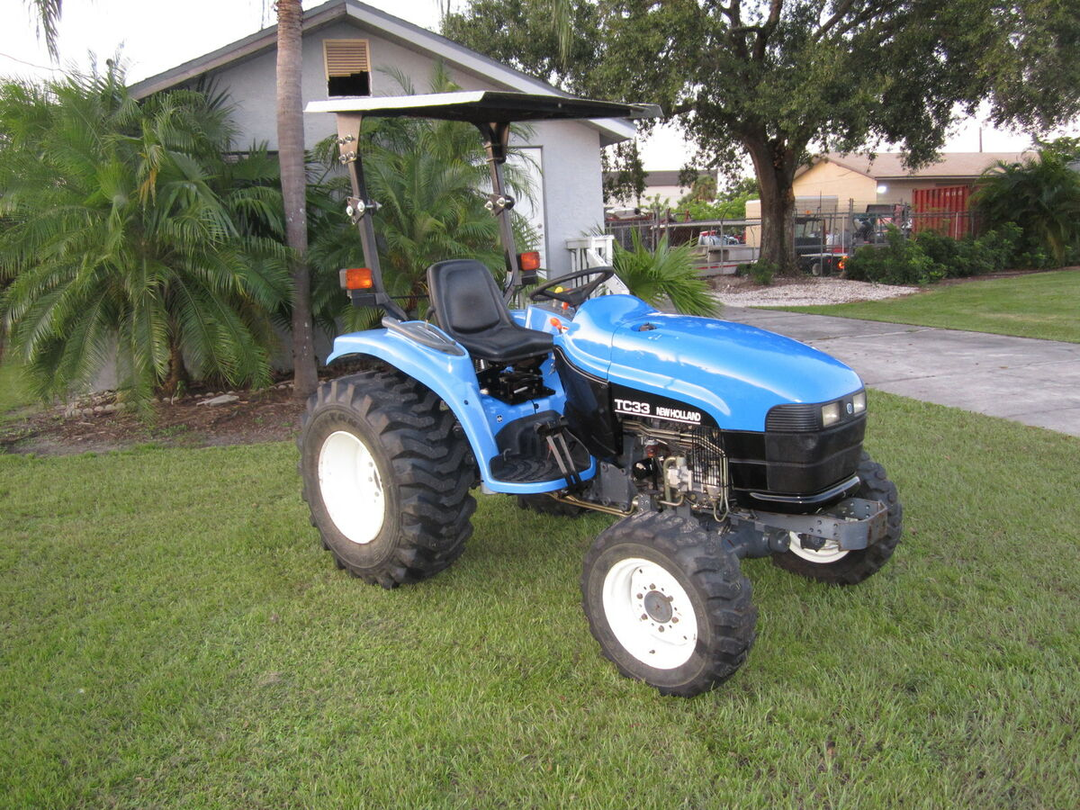 holland tc 33 diesel compact tractor 4 wheel drive r3 tires 558 hrs on popscreen. Black Bedroom Furniture Sets. Home Design Ideas