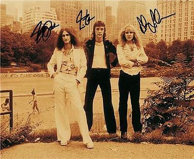 RUSH BAND GROUP SIGNED PHOTO 8X10 RP AUTOGRAPHED... 1974....NEIL PEART GEDDY LEE in Sports Mem, Cards & Fan Shop, Autographs-Reprints | eBay