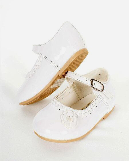 Girls' dress shoes with a subtle little heel give her a fashionable look with a comfortable feel. Pretty details like bow appliques at the toe or buckle closures at the ankle strap lend plenty of chic appeal.