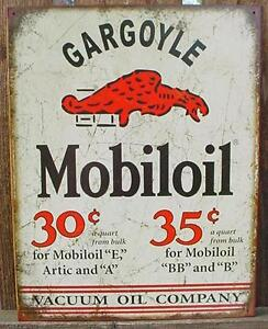 Metal Gas And Oil Signs http://www.ebay.com/itm/Vintage-Metal-GARGOYLE-MOBILOIL-MOBIL-Ad-Sign-SERVICE-GARAGE-GAS-OIL-Tin-NEW-/111074565423