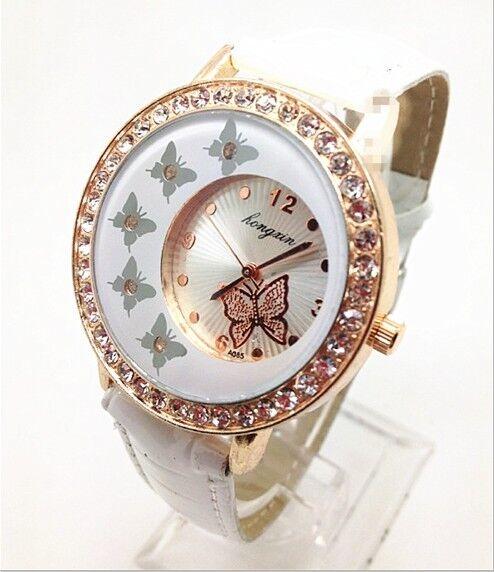 White crystals around butterfly inside girl's quartz watches