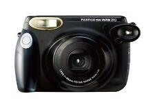 Analoge Kameras mit eingebautem Blitz und Film