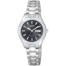 Runde Quarz - (solarbetriebene) Armbanduhren mit Datumsanzeige für Damen