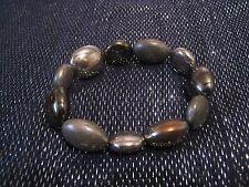 Lovely elasticated beaded bracelet with gold tone plastic beads some matt