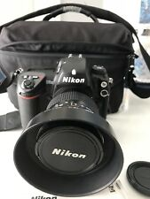 Nikon D2H professional DSLR body with 28-200 zoom lens.