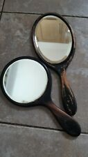 A Pair Of Antique Wooden Hand Held Vanity Mirrors