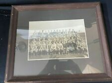 VINTAGE FRAMED TEAM PHOTO OF FOOTBALL PLAYERS SITTING IN THE BLEACHERS Ca 1930s
