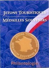 Album de poche pour 6 médailles souvenirs ou jetons touristiques.