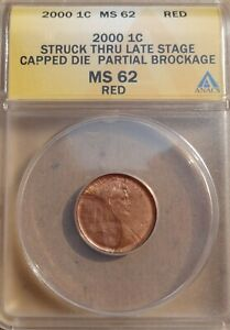 2000-P LINCOLN CENT ANACS STRUCK THRU LATE STAGE CAP DIE AND PARTIAL BROCKAGE