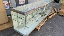 Store display case 10 Ft long 2 feet deep. Stainless steel corner trims