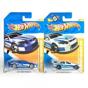 Hot Wheels 2012 Ford Falcon Race Car 2 Pack BLUE and WHITE V8 Supercars