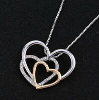Collier, pendentif triple coeur argenté et doré avec strass blanc.