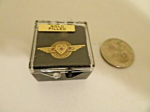 Southwest Airlines service pin 20 year gold filled 3 rubies