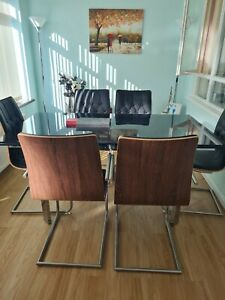 Extending glass dining table and 6 chairs