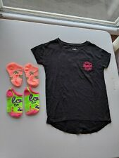 LOT OF THREE GIRLS CLOTHING ITEMS: JUSTICE T-SHIRT & 2-PAIRS SOCKS (SIZE: 6/7)