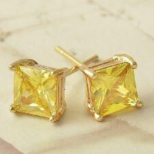 Stud circonitas color ambar con oro amarillo laminado 18 kt envio gratis