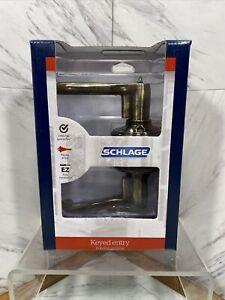 Schlage Flair Antique Brass Steel Entry Lockset ANSI Grade 2 1-3/8 in.