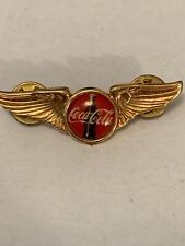 """COCA-COLA GOLD COLORED WING LAPEL PIN, SHOWING BOTTLE, NEW OLD STOCK  2"""" X 2/3"""""""