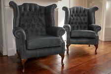 A pair of Queen Anne wing back chair and footstool in vintage grey leather