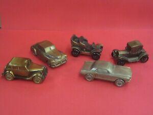 Vintage Banthrico cast metal rolling car coin banks bronze finish Lot of 5