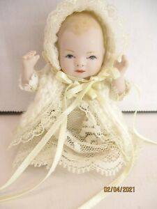 """Porcelain Baby 4"""" Jointed head, hips and shoulders hand painted darling outfit"""