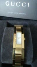 Gucci  Wrist Watch for Women.gold color, 7 inches with 2 extra links,box ,book.