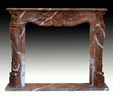 Red marble fireplace surround or front. After french Louis XV style. 20th centur