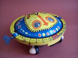 Old plastic and tin space toy UFO made in USSR wind up