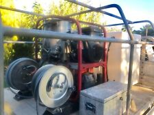 Hot and cold pressure washer 700 L tank high and low pressure hose reels.