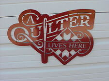 """A Quilter Lives Here - Red Metal 24"""" x 16"""" (approx) Barn Quilt Block Sign"""