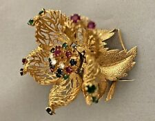 Exquisite 14K flexible flower brooch with diamonds rubies, sapphire, and emerald