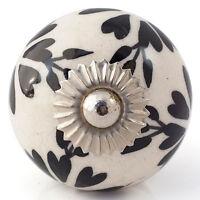 Ceramic door knob on wooden door stop.Choose your design. Black white patterned.