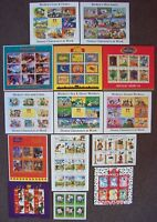 14 x DIFFERENT DISNEY MINT STAMP SHEETS .