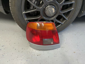 Audi A4: 1996, 1997, Left - Driver Tail light With Lower Trim