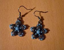 Oorbellen hangers bloem met blauwe steentjes